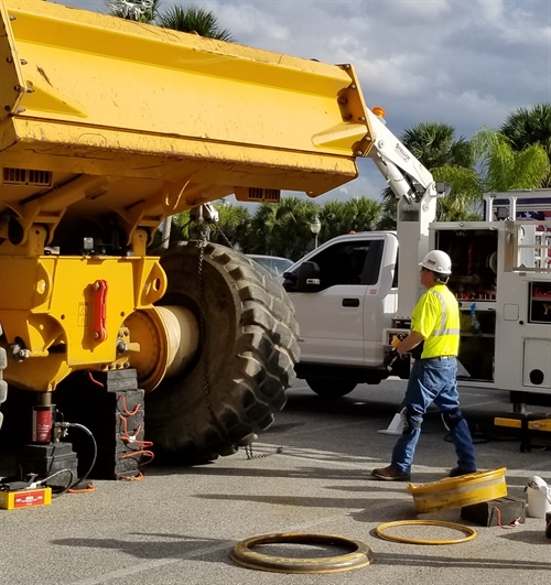 The live demonstration of a 29.5R25 tire being replaced on a five-piece rim helped promote TIA'sOTR technician training program.
