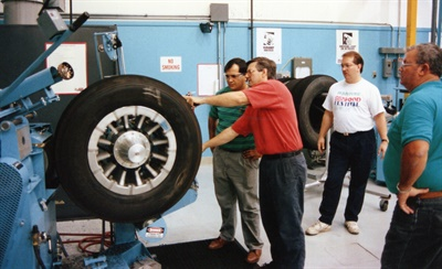 Bob Majewski, then- ARA technical director (in red at the buffer), teaching a hands-on retread class at the ITRA Training Center.