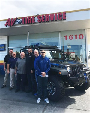 Pictured from left to right are Gabriel Baltimore and Jeff Reynolds (TWI); Armando Valenzuela and Armando Valenzuela Jr., winner of the customized Jeep Wrangler Sport (AV Tire Service); and Mark Richter and Wes Samperio (Falken Tire).
