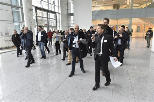 Ingo Riedeberger, right, leads the The Tire Cologne pre-show tour for European journalists.