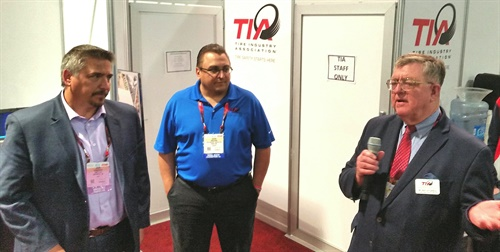 Roy Littlefield, right, Kevin Rohlwing, center, and JohnEvankovich shared the spotlight during the TIA press conference at the Global Tire Expo.