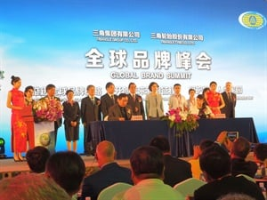 Tao Zhang, CEO of Triangle Tyre Co. Ltd., and Yhui Wang, vice president of the Shandon Branch of The Export-Import Bank of China, seated left to right, sign a strategic agreement that allows Triangle to invest funds outside of China.
