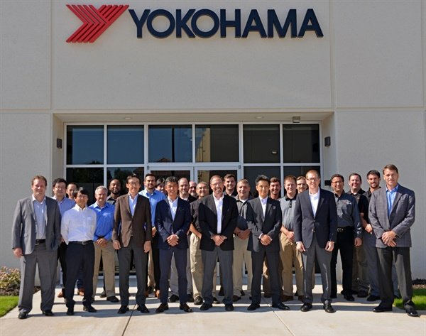 Yokohama Tire Corp.'s Shinichi Takimoto (front row, fourth from left), joined YCNA's Tetsuya Kuze (third from left) and Shoichiro (Sho) Matsuda (sixth from the left), at the grand opening of the Yokohama Development Center America. The 25,000-square-foot R&D center is located in Mecklenburg County, N.C.