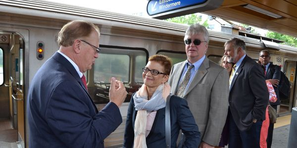 McMillan talks with Greater Cleveland Regional Transit Authority CEOJoe Calabrese during a tour...