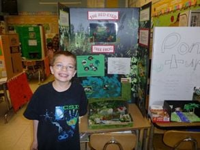 This photo taken of 7-year-old Kyron Horman with his science project on the morning of his disappearance has been circulated in the media, on posters and in missing-person shirts that his family ordered to give out.