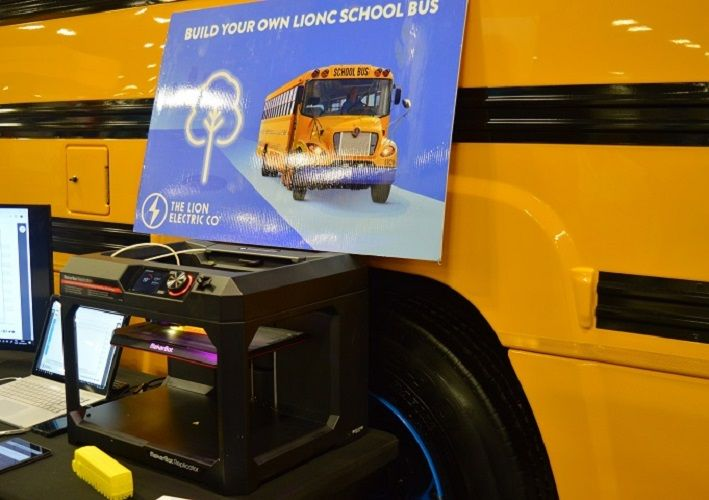 On display at The Lion Electric Co. booth was a 3D printer creating mini LionC school bus models...