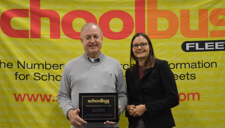 School Bus Fleet's Executive Editor Nicole Schlosser presented the Administrator of the Year...