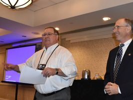 Mike LaRocco, the president of NASDPTS and Indiana state director (shown left), introduced Bruce...