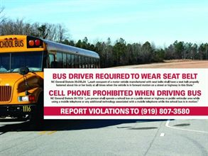 In an innovative pilot program in North Carolina, a sticker inside school buses explains that drivers must wear their seat belts and refrain from talking on cell phones while driving. Below those state statutes is a number to call to report violations.