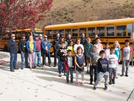Alturas Elementary School students, the school's principal, and bus drivers teamed up with local...