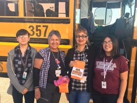 Student council officers from Ysleta High School in El Paso, Texas, took time to give bus...