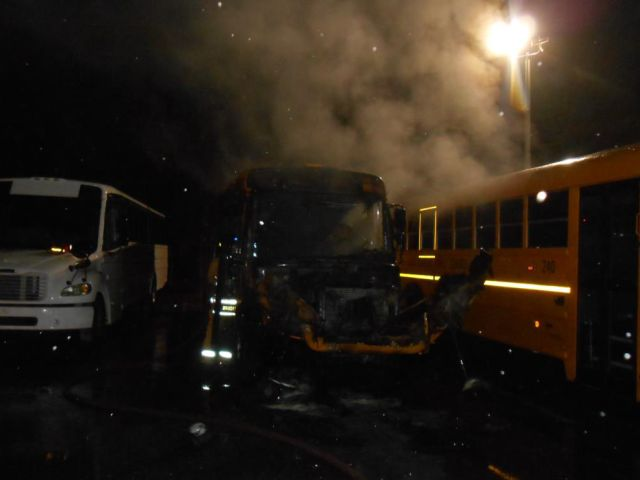 2 school buses burn in suspected arson