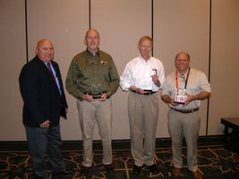 Tom Formanek recognized outgoing board members during the TIA meeting, from left, Chris Monroe,...