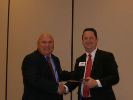 Outgoing TIA President Tom Formanek, left, passed the presidential gavel to David Martin from...