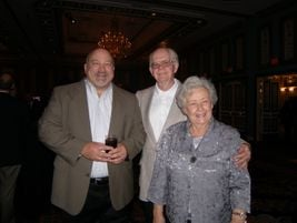 Chris Robinson of Goodyear Tire & Rubber Co. is pictured with John and Janice Kelsey, owners of...