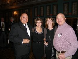 TIA Past President Tom Formanek and his wife Brenda, left, share a moment with Rosie and Dan...