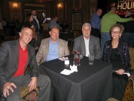 Carole Rhodes, far right, mother of Tire Dealer of the Year Award winners Mark and Scott Rhodes,...