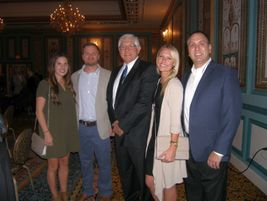 Modern Tire Dealer's Bob Marinez, center, is pictured with members of the Hennessy Industries...