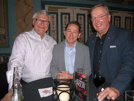 Bob Majewski of Sumerel Tire Service, left, David Stevens, managing director of the Tire Retread...