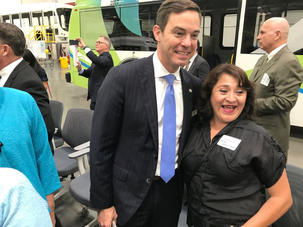Proterra CEO Ryan Popple poses with Ana Sanchez, the mother of a Proterra team member working at...