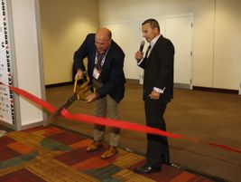 TEMSA North America National Sales Manager Randy Angell cut the show floor ribbon with METRO GM...