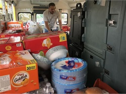 Nolan Correa, associate superintendent of support services for Humble Independent School District (ISD) near Houston, helps fill school buses with food donations. Photo courtesy Humble ISD