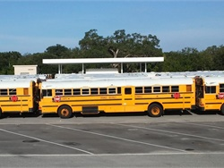 Before the arrival of Hurricane Irma, Orange County Public Schools in Orlando positioned and prepared about 1,000 school buses. The prep work included refueling the buses, parking them close together, securing passenger doors with bungee cords, and fastening stop arms with zip ties.