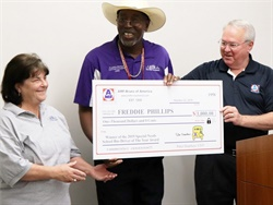AMF-Bruns will honor a special-needs school bus driver for their standout service for the third year in a row. Pictured center is Freddie Phillips, the winner of last year's award. Photo courtesy AMF-Bruns