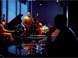 The Blue Room is designed to resemble a nightclub from the 1930s featuring live music, but is also an exhibit that displays artifacts of Kansas City jazz. Photo by the American Jazz Museum
