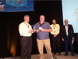 Marshall Casey (left) presented Raymond Dickens of West Virginia with the top America's Best award in the Inspectors category.