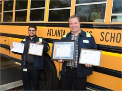 Oliver Baird (left) and Brian Purtymun of Atlanta Public Schools attained the Master School Bus Technician certification from ASE.