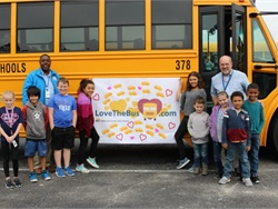 School bus drivers and other transportation staff members across the U.S. were honored in Love the Bus celebrations in February. Shown here, students from Bolivia (N.C.) Elementary School pose for a photo with their bus drivers while holding up a Love the Bus poster. Photo courtesy Brunswick County Schools