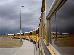 Jefferson County (Ky.) Public Schools started a pilot program that pays school bus drivers and special-needs assistants a $200 bonus for every pay period they come to work every day to address driver shortage and absenteeism. Photo by John Horton