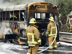 Authorities say that a school bus driver noticed smoke and pulled to the shoulder. The driver and three teachers who were on board helped 23 students safely evacuate before firefighters arrived. Photo courtesy CHP West Valley