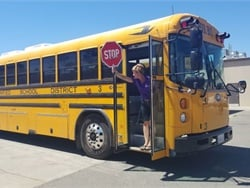When unloading, do not step off the bus before sticking out the hand-held stop sign and checking both directions alongside the bus for hazards.