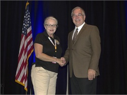 Jerene Jones, transportation director for Catoosa County Public Schools, accepts a Pupil Transportation Safety Award from State School Superintendent Richard Woods.