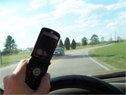 Passengers can easily capture drivers' actions on their phones and post them online. In May, a student in Illinois shot video of his bus driver texting while driving. Stock photo by Ed Brown