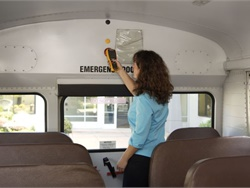 Zonar's downloadable list is designed to help California pupil transporters ensure full compliance with a law requiring child-check reminder alarm systems on school buses. Shown here is a child check being conducted with the Zonar EVIR system.