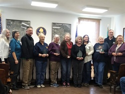 Mayor Ken Tedford (second from right) and the Fallon City Council recognized seven Churchill County (Nev.) School District drivers for their decades of service. Photo courtesy Gayle Webb