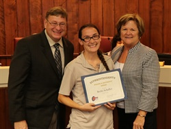 "Citrus County (Fla.) School District presented Becky Schaffer (center) with the district's ""Making a Difference Award"" after she helped prevent a student from being hit by a truck that illegally passed her bus in April. Photo courtesy Citrus County School District"