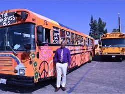 Colton (Calif.) Joint Unified School District rolled out a message of kindness on one of its school buses for Anti-Bullying Awareness Month. Shown here is Erick Richardson, the district's transportation director, who came up with the idea for the Kindness Bus.