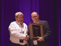 NAPT President Barry Sudduth presented Peter Mannella (right), longtime NAPT member and former executive director of the New York Association for Pupil Transportation, with the association's Distinguished Service Award.