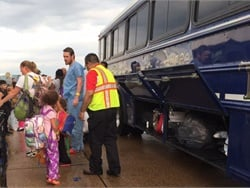 Dallas (Texas) County Schools assisted in local hurricane emergency response efforts on Monday evening, sending up to four activity buses to transport evacuees being flown into Love Field to a shelter in Irving. Photo courtesy Lisa LeMaster