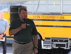 Dean Transportation recently marked 50 years in the pupil transportation industry. Shown here is Kellie Dean, president of Dean Transportation, speaking at a back-to-school event hosted by the company in August. Photo courtesy Dean Transportation