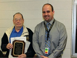 Donald Arndt (left) began working for Marion School District in 1960, first as a technician and then as a school bus driver. Arndt, shown here with James Bena, the district administrator, was honored by the district with a plaque for his retirement this year. Photo courtesy of The Marion Advertiser.