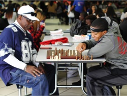 Donald Harris shares his newfound love of chess with students, teaching them the game during his time off in an effort to connect with them and encourage them to further their education. Photo courtesy Duncanville (Texas) Independent School District