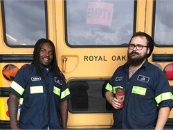 Durham School Services received a score of 100% from Michigan State Police for its fleet of 25 buses, which serve Royal Oak School District. Shown here are Antwan Evans, left, and Bradley Bolton, members of the maintenance team.