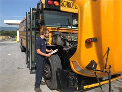 Mechanics at Frederick County (Md.) Public Schools added a School Bus Courtesy Check list for buses coming to the shop to proactively check for and advise drivers of additional issues. Shown here is Cody Burtner, one of the mechanics who developed the checklist, performing a School Bus Courtesy Check.