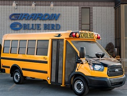 Girardin Blue Bird has acquired Connecticut-based dealer School Lines. Shown here is a Micro Bird T-Series in front of Girardin Blue Bird's headquarters in Drummondville, Quebec. Photo courtesy Girardin