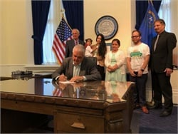 Nevada Gov. Steve Sisolak signed into law a bill that makes electric bus and infrastructure funding available to school districts. Photo courtesy Gov. Sisolak's Office